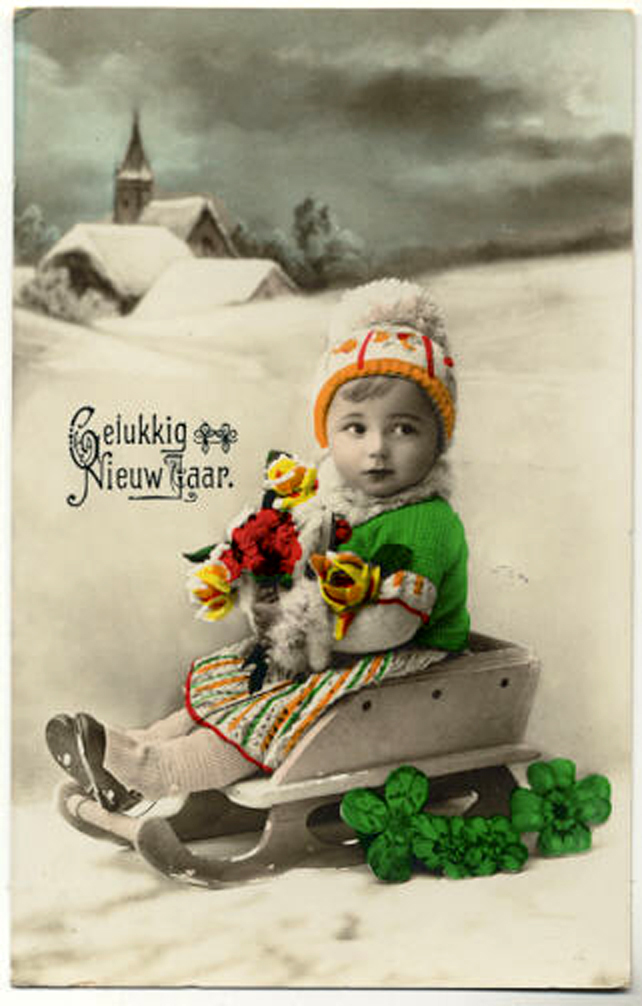 Girl on sled with clover